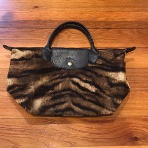 Longchamp velvet leopard print bag.